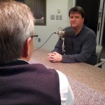 Mike Tobias talks with UNL economist Eric Thompson. (Photo by Bill Kelly, NET News)