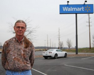 Produce broker Herman Farris stands in the parking lot of the eastside Wal-Mart in Columbia, Mo., before heading to St. Louis to pick up a shipment of bananas for Wal-Mart. (Photo by Abbie Fentress Swanson, Harvest Public Media)