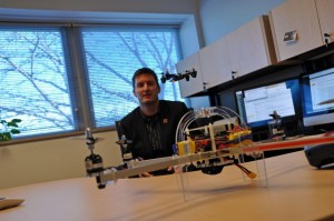 Professor Matt Waite practices flying his micro UAV in his office at the University of Nebraska-Lincoln. On his desk sits the larger UAV, which can hold a small camera. (Photo by Ryan Robertson, NET News)