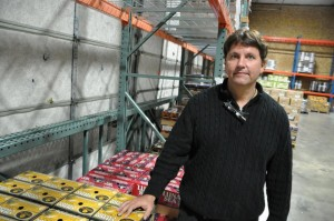 "Milan ""Deder"" Knezovich II is the president of K & Z Distributing Co. Inc. in Lincoln. Inside K & Z's 52,000 square foot facility is a special cooler, specifically designed to keep certain beer varieties cold to maintain freshness and flavor. (photo by Ryan Robertson, NET News)"