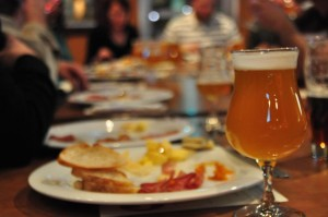 Beer pairing events are a growing trend with craft beer enthusiasts. Nebraska Brewing Company recently partnered with The French Bulldog, a delicatessan restaurant in Omaha. The restaurant supplied charcuterie, which is an assortment of cured meats, cheeses, bread, and special spreads. The charcuterie was paired with Nebraska Brewing Company's Apricot Au Poivre Saison, which was named the nation's best barrell aged beer in 2011. The owners of Nebraska Brewing Company, Paul and Kim Kavulak, say much like wine, the complex ingredients in craft beers can enhance the flavor of food and add to the dining experience. (photo by Ryan Robertson, NET News)