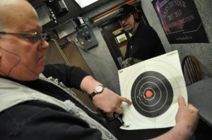 Craig Schneider displaying the pattern of shot placement after time spent on the shooting range at Thunder Alley in Lincoln. (Photo by Ryan Robertson, NET News)