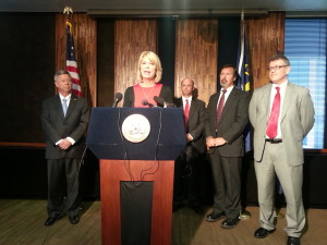 Mayor Jean Stothert talks about the partnership between the City of Omaha and the Nebraska Department of Roads. She is joined by Gov. Dave Heineman; City Engineer Tim O'Bryan;City Engineer Todd Phitzer; and Director of the Nebraska Department of Roads Randy Peters. (Photo Courtesy KVNO News)