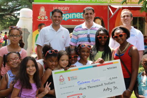 (L-R) Andy D'Agosto and Alan D'Agosto own several local Arby's restaurants. They presented a $5,000 check to Solomon's Girls. (Photo Courtesy of KVNO News)