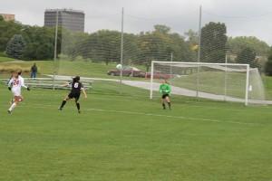 Chelsi Rohloff (6) scored her second goal of the year here one-on-one against USD's Mackenzie Viktor. (Photo Courtesy KVNO News)