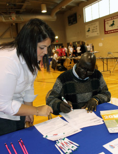 Andreya Mayom fills out an application for the Affordable Care Act with the help of Stephanie Torres from the Charles Drew Health Center. (Photo Courtesy KVNO News)