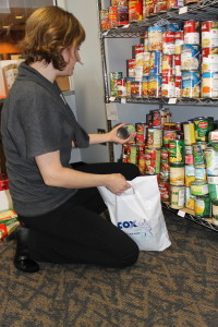 Katherine Kaiser packs a food bag while at the Maverick Food Pantry. (Photo Courtesy KVNO News)
