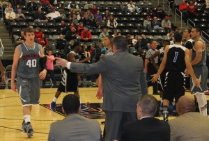 Assistant coach Randall Herbst directs Simon Krych (40) during a timeout. (Photo Courtesy KVNO News)