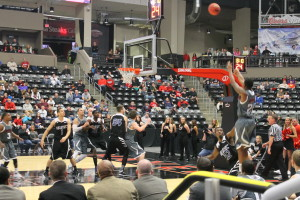 UNO's Justin Simmons (21) attempts a jump-shot late in the second half. (Photo Courtesy KVNO News)