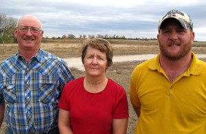 Jake and Vicki Wasserburger (left) ranch and feed cattle near Crawford, Neb. with their son, J.R. (right). They lost around 50 cattle in the blizzard. (Photo by Grant Gerlock, NET News/Harvest Public Media)