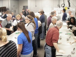 Volunteers prepare to serve food early on Thanksgiving Day. (Photo Courtesy KVNO News)