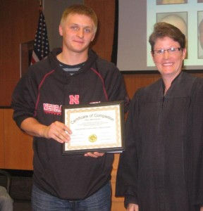 Judge Jodi Nelson with a Drug Court graduate. (Photo courtesy of Lancaster District Court)