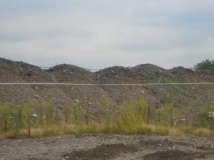These piles of dirt are undergoing the bioremediation treatment process. (Photo by Michelle Kanu, QUEST Ohio)