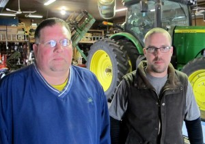 Dave Beck (left) calls Dyrek Zoucha (right) the farm's tech guru. He does most of the work managing data and software. (Photo by Grant Gerlock, NET News/Harvest Public Media)