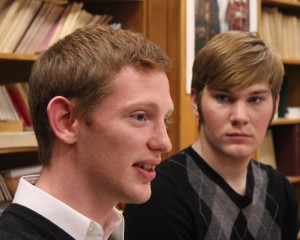 Walker Edwards listens as ethics team member Kyle Kettler presents (Photo by Bill Kelly, NET News)