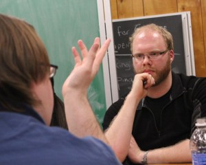 Oliver Tonkin, ethics team member, listens during a practice session. (Photo by Bill Kelly, NET News)