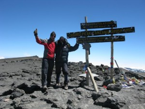 Kay (left) at highest point in Africa, one of the continental summits he has climbed (photo courtesy Robert Kay)