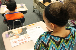 "A fourth grade student prepares to complete an activity related to the book ""My Name is Yoon."" (Photo Courtesy KVNO News)"