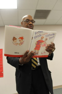 Ken Butts, member of Alpha Phi Alpha, reads to a class of fourth graders. Butts has been visiting the school to read to students for several years. (Photo Courtesy KVNO News)