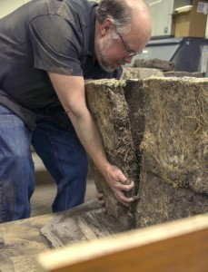 According to Dave Wedin, the density of the roots in the sod bricks are what makes the bricks so sturdy, even after 110 years. He tested the integrity of the sod by submerging a block in water - it has yet to dissolve after three weeks. (Photo by Peter Stegen, Platte Basin Timelapse)
