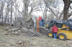 Members of the Custer County Historial Society get ready to pull down the sod wall. (Photo by Jackie Sojico, NET News)
