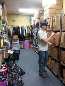 Shawn Miller takes stock of clothing and toiletries at the emergency shelter. (Photo Courtesy KVNO News)