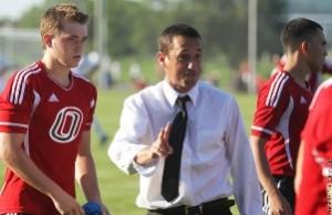 Head Coach Jason Mims gives his team orders. (Photo Courtesy UNO Athletics)