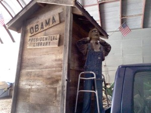 A float depicting President Obama's library as an outhouse got cheers at Norfolk's annual Fourth of July parade, but stoked controversy after it was spread across social media. Charges of racism also flew from within the community and from outsiders who saw coverage in the national news media. (Photo by Bobby Caina Calvan, The Heartland Project)