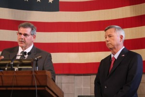 Corrections Director Mike Kenney announces disciplinaryactions as Gov. Dave Heineman looks on. (Photo by Fred Knapp, NET News)