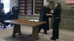 Chief Justice Heavican honors graduate Tera Newcombe.