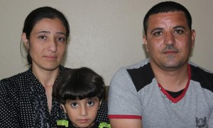 Shireen Ismael, left, and Shahab Abdullah, right, with their son Shaher, center (Photo by Fred Knapp, NET News)