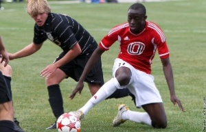 UNO's Vance Rookwood (red) leads the Summit League in goals (5) and points (10) (Photo courtesy UNO Athletics)