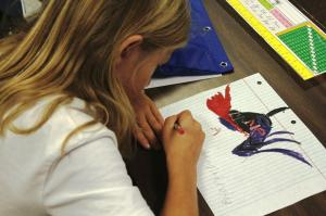 "A student in Meghan Roeser's third grade class at Seedling Mile Elementary school in Grand Island participates in one of several ""Daily Five"" learning activities. (Photo by Ben Bohall, NET News)"