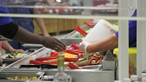Nearly one-third of the more than 400 million pounds of food available at grocery stores and restaurants is never eaten. (Photo by Kristofor Husted, Harvest Public Media)