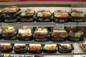 Pre-made meals found in the prepared food aisle are a growing source of food waste, as it is difficult to re-use meals that aren't sold but are fully cooked. (Photo by Kristofor Husted, Harvest Public Media)