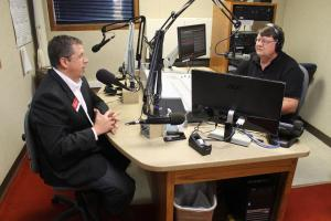 Watson (L) talks with KRVN news director Dave Schroeder (Photo by Mike Tobias, NET News)