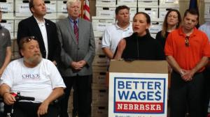 Danielle Conrad of Nebraskans for Better Wages delivers petitions. (Courtesy of Appleseed Center)