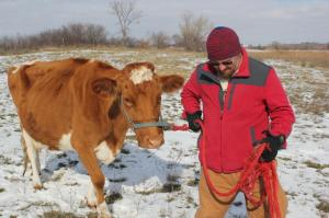 William (pictured above) and Crystal Powers are turning to online crowdfunding to help lay the foundation for a significant expansion at their farm in Ceresco, Nebraska. (Photo by Ben Bohall, NET News)