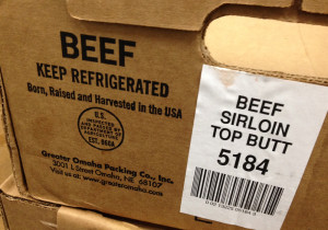 Most beef comes boxed in large cuts that are broken down at the supermarket. The information on the box tells retailers what to say on the country of origin label shoppers find on the shelf. (Photo by Grant Gerlock, NET News/Harvest Public Media)
