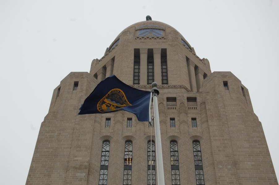 Nebraska flag flies below Capitol tower (Photo by Fred Knapp, NET News)