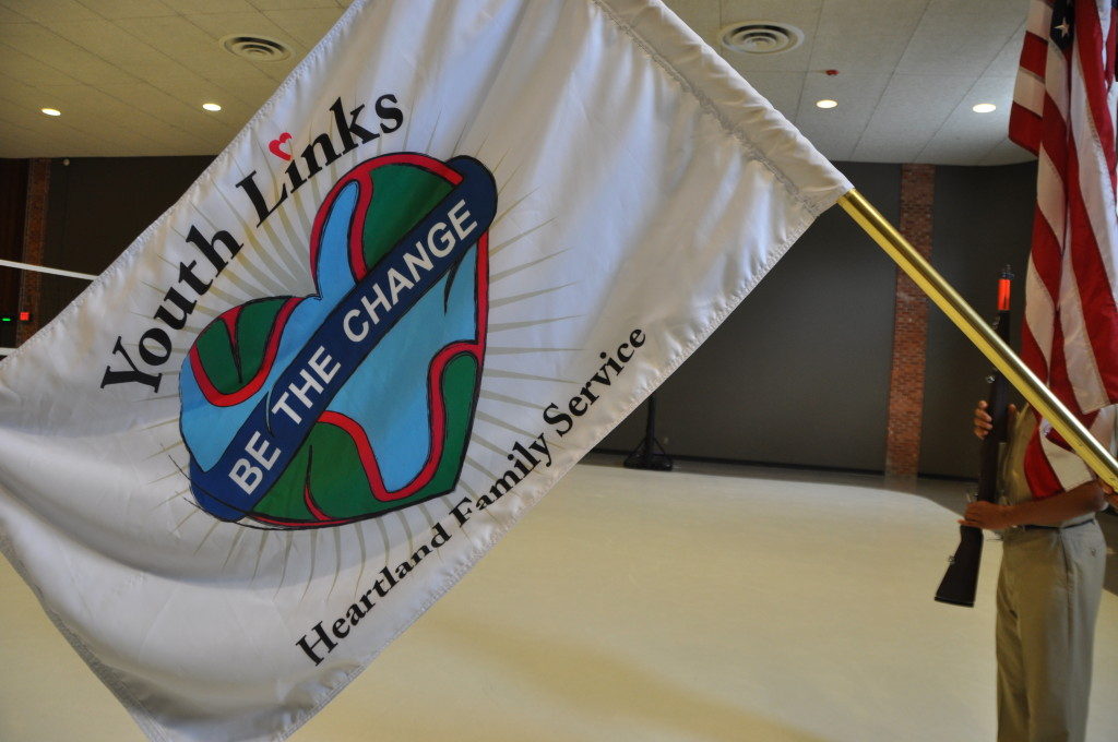 The official flag of the Heartland Family Services Youth Links program, designed by members of the color guard. (Photo by Ryan Robertson, KVNO News)
