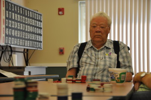 Louis Garrod weighs his options while playing a hand of poker. (Photo by Ryan Robertson, KVNO News)