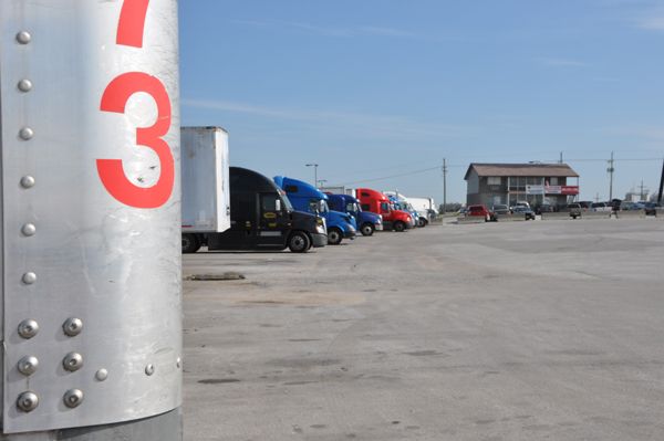 Big rig trucks line up outside a truck stop near Omaha. Due to a nation-wide driver shortage, there are close to 40,000 open jobs in the trucking industry. (Photo by Ryan Robertson, KVNO News)