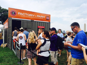 People attending a Chipotle Cultivate Festival in Kansas City in July lined up for an exhibit on what is often called factory farming, or the industrial agriculture system. Attendees needed to go through four exhibits to get a free burrito. (Peggy Lowe/Harvest Public Media)