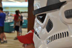 "A ""Storm Trooper"" stands motionless while a young fan waits for his picture to be taken. (Photo by Ryan Robertson, KVNO News)"