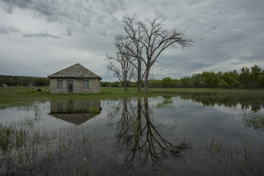 Water flooding from the North Platte River surrounds a shed near Lewellen, Nebraska. (Photo by Peter Stegen, Platte Basin Timelapse)