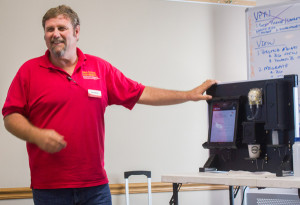 ISU Extension's Carl Pederson demonstrates a portable soil testing machine that can offer results of nitrogen content within minutes, right in a farmer's field. (Photo by Amy Mayer/Harvest Public Media)