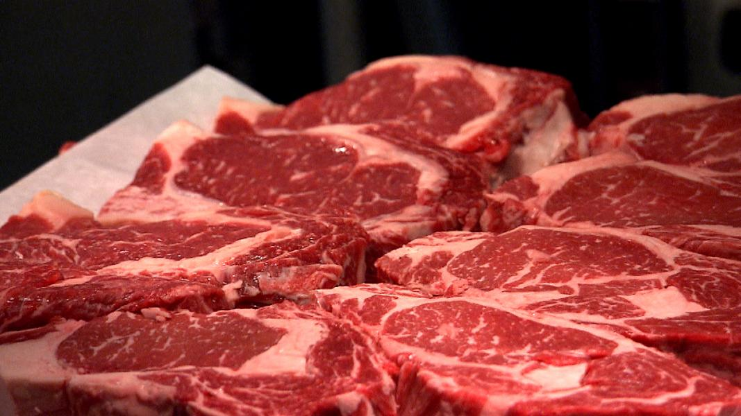 A platter of steaks is ready to grill at 801 Chophouse, an upscale steakhouse in Omaha, Neb. The most expensive steak on the menu is a 24 oz. Porterhouse that sells for $65. (Photo by Brian Seifferlein, Harvest Public Media)