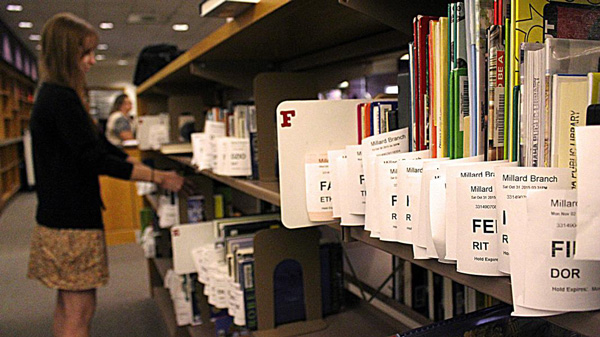 Setting aside reserved books at the Millard branch of the Omaha Public Library. (Photo by Bill Kelly, NET News)