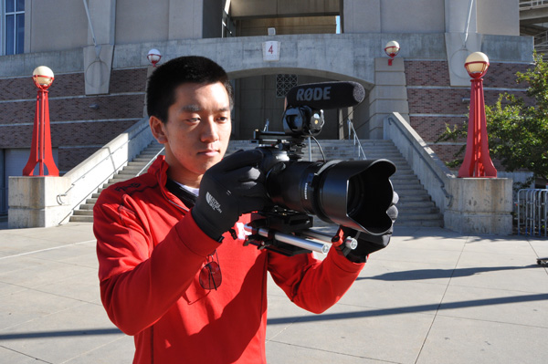 Arthur Nguyen is an architecture student at UNL. He said without social media, he wouldn't have been given a job shooting video for Husker Athletics. (Photo by Ryan Robertson, KVNO News)
